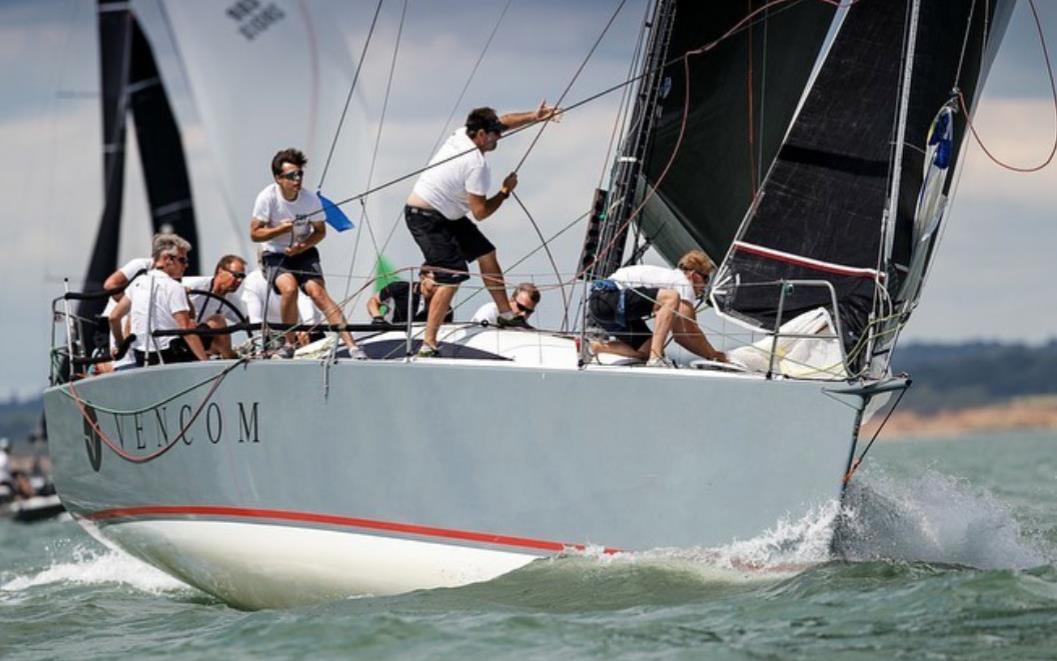 photo of sailors on yacht